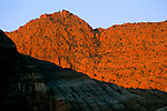 Sunrise light on red sandstone peak in Snow Canyon State Park, Ivins, Utah's Dixie, near St. George, UTAH