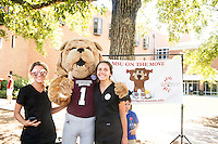 Bully posing with two member of the health center staff at the MSU on the Move celebration ceremony<br />  (photo by Beth Wynn / &copy; Mississippi State University)