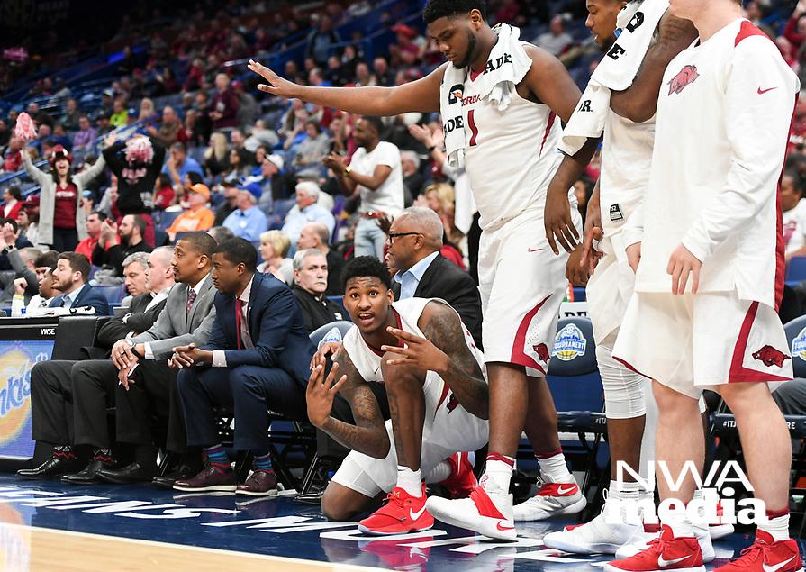 NWA Democrat-Gazette/CHARLIE KAIJO Arkansas Razorbacks players react following a three-pointer during the Southeastern Conference Men's Basketball Tournament, Thursday, March 8, 2018 at Scottrade Center in St. Louis, Mo.