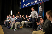 Students from Dublin School watch as former senator Rick Santorum arrives at a town hall meeting at Dublin School in Dublin, New Hampshire, on Jan. 6, 2012.  Santorum is seeking the 2012 GOP Republican presidential nomination.  The students are members of a club that worked to invite candidates to visit the school.