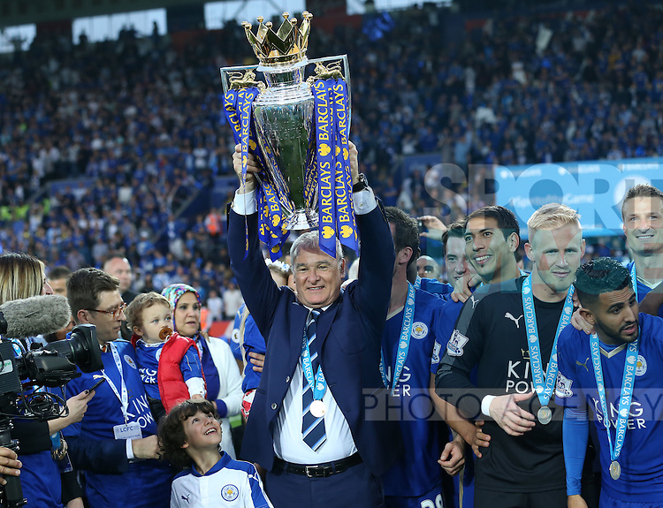 Leicester's Claudio Ranieri celebrates with the trophy during the Barclays Premier League match at the King Power Stadium.  Photo credit should read: David Klein/Sportimage