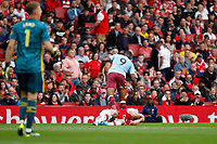 Sokratis Papastathopoulos of Arsenal and Wesley of Aston Villa during the Premier League match between Arsenal and Aston Villa at the Emirates Stadium, London, England on 22 September 2019. Photo by Carlton Myrie / PRiME Media Images.