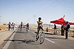 SULAIMANIYAH, IRAQ: Cyclist Nyan Yassin crosses the finish line in the individual team event.  Members of the club can break away in this event but Newroz cycling club raced as a team. <br /> <br /> Nyan Yassin, 24, is a professional competitive cyclist in Sulaimaniyah in the semi-autonomous region of Iraqi Kurdistan.  She is the captain of an all-female club called Newroz Club, which is the only cycling club for women in Sulaimaniyah, although there are other clubs around Iraq.  She trains and competes on roads that are badly surfaced and busy with traffic.<br /> <br /> Nyan was the first woman to start cycling in Sulaimaniyah.  She was always competitive and after trying her hand at different sports she settled on cycling.  She is now the top female cyclist in Iraq.  Her nickname is MigMig after the noise made by the cartoon character Roadrunner.<br /> <br /> Despite being clearly talented at her sport Nyan knows that in a couple of years she will have to get married and then abandon it as, in the traditional society that Kurdistan is, being a wife and a competitive sportswoman at the same time is not an option.<br /> <br /> Photo by Gona Hassan/Metrography