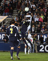 Darren Mattocks #11 of the University of Akron heads over Kofi Opare #6 of the University of Michigan during the 2010 College Cup semi-final at Harder Stadium, on December 10 2010, in Santa Barbara, California. Akron won 2-1.