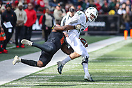 College Park, MD - November 3, 2018: Michigan State Spartans quarterback Brian Lewerke (14) is tackled by a Maryland Terrapins defensive lineman Jesse Aniebonam (6) during the game between Michigan St. and Maryland at  Capital One Field at Maryland Stadium in College Park, MD.  (Photo by Elliott Brown/Media Images International)