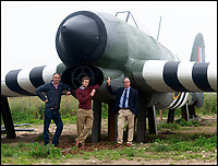 BNPS.co.uk (01202 558833)<br /> Pic: RogerArbon/BNPS<br /> <br /> Philip Ewen CVHF, Chris Blakeborough (designer) and Geoff Clarkson (Leader of systems engineering at QinetiQ).<br /> <br /> Super-sized Typhoon appears on a Dorset hillside...<br /> <br /> Apprentices working for QinetiQ at Boscome Down in Wiltshire have constructed a super-sized model of the Hawker Typhoon for the Chalke Valley History Festival near Salisbury this week.<br /> <br /> The huge 4x scale model of the rocket carrying fighter has been placed on a hillside overlooking the Festival that opened yesterday. <br /> <br /> The fighter bomber known as 'Tiffy' by its pilots played a key role attacking German troops, tanks and trains during the battle for Normandy, disrupting Nazi attempts to resupply their beleagured forces. <br /> <br /> There are no airworthy Typhoon's still flying today, although the Typhoon Preservation Trust has plans to restore one to flying condition by 2020.