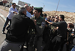 Israeli policemen detain a Palestinian protester during clashes at a demonstration against West Bank Jewish settlements, in the West Bank village of Al-Eizariya, near Jerusalem November 25, 2013. An army spokesman said 4 protesters were detained on Monday for disturbances during the demonstration. Photo by Issam Rimawi