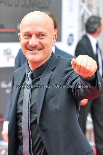 Italian TV star and actor Claudio Bisio greets his fans at an awards giving cerimony in Rome on May 7, 2010.