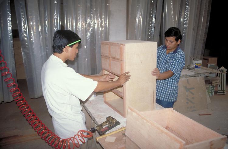 Artisans working in furniture factory, Lima, Peru.  CD scan from 35mm film  © John Birchard
