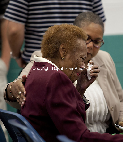 NIANTIC, CT-9 October 2013-100913BF09- Faye Vinson, the mother of murder victim Joyce Amos, wipes a tear as she is comforted by State Judicial Branch Victims Advocate Carmen Sierra during a clemency hearing for Bonnie Foreshaw who was convicted of murdering Amos in the 1980's. Foreshaw was granted clemency by the three person panel during the hearing held at Gates Correctional in Niantic Wednesday. Bob Falcetti Republican-American