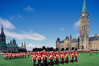 Changing of the Guard Ceremony at the Parliament Buildings on Parliament Hill, in the City of Ottawa, Ontario, Canada - West Block (built 1865) and Centre Block with Peace Tower (built 1865 - 1927)