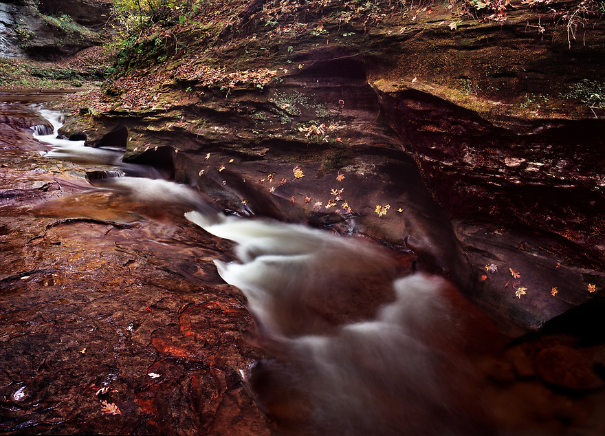 """Fall Creek Gorge, in rural Warren County, Indiana, is a popular place that local people have gone to for many years. Most people in the area refer to the place as """"The Pot Holes."""" This small nature preserve is a great place for a walk in the woods during any season, but the rich colors can be their best in autumn."""