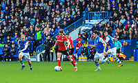 Barnsley's forward Tom Bradshaw (9) turns in midfield away from Sheffield Wednesday's midfielder Kieran Lee (5) during the Sky Bet Championship match between Sheff Wednesday and Barnsley at Hillsborough, Sheffield, England on 28 October 2017. Photo by Stephen Buckley / PRiME Media Images.