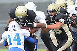 Palos Verdes, CA 09/16/11 - Joey Augello (Peninsula #58), Keishawn Haley (Culver City #14) and Okuoma Idah (Peninsula #24) in action during the Culver City-Peninsula varsity football game.