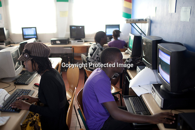 CAPE TOWN, SOUTH AFRICA - APRIL 20: Unidentified students work on the computers on April 20, 2012 in Cape Town, South Africa. They study for a certificate in basic computer knowledge. THe course is 3-6 months. The students come from poor backgrounds and have been unemployed until they come here. iThemba Labantu offers these young men and women the opportunity to learn a trade so that they will be able to earn a living for themselves and their families one day. (Photo by Per-Anders Pettersson For Global Post)