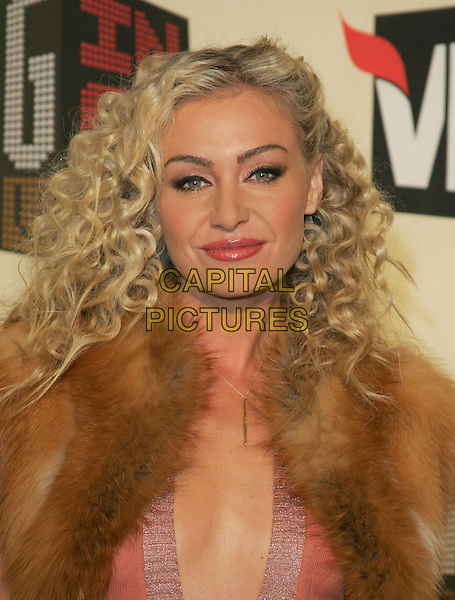 PORTIA DE ROSSI.The VH1 Big in 04  Award Show held at The Shrine Auditorium in Los Angeles, California .December 1, 2004.headshot, portrait, plunging neckline, fur wrap, vest, collar.www.capitalpictures.com.sales@capitalpictures.com.Supplied by Capital Pictures