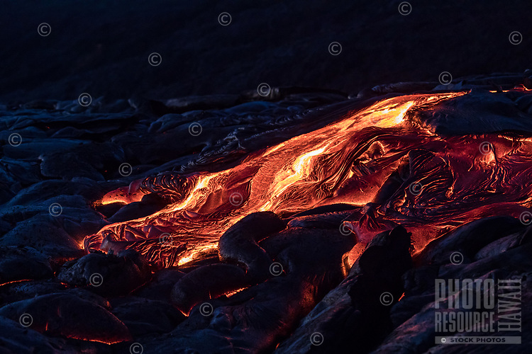 Molten lava flows over the coastal plains of Pulama Pali (part of Holei Pali), Hawai'i Volcanoes National Park, Puna, Hawai'i Island, January 2018.