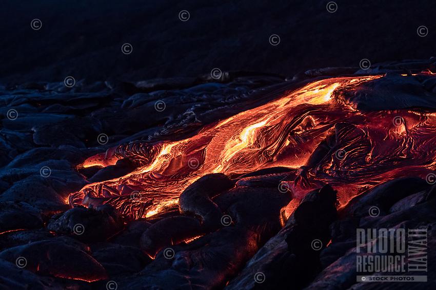 Molten lava flows over the coastal plains of Pulama Pali (part of Holei Pali), Hawai'i Volcanoes National Park, Puna, Hawai'i Island, January 2018.