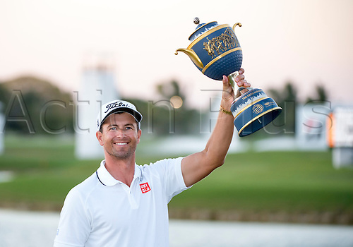 06.03.2016. Doral, Florida, USA. Adam Scott of Australia smiles as he holds the trophy in the air after winning the final round of the World Golf Championships-Cadillac Championship on the TPC Blue Monster course at the Trump Doral Golf Club and Resort in Doral, FL.