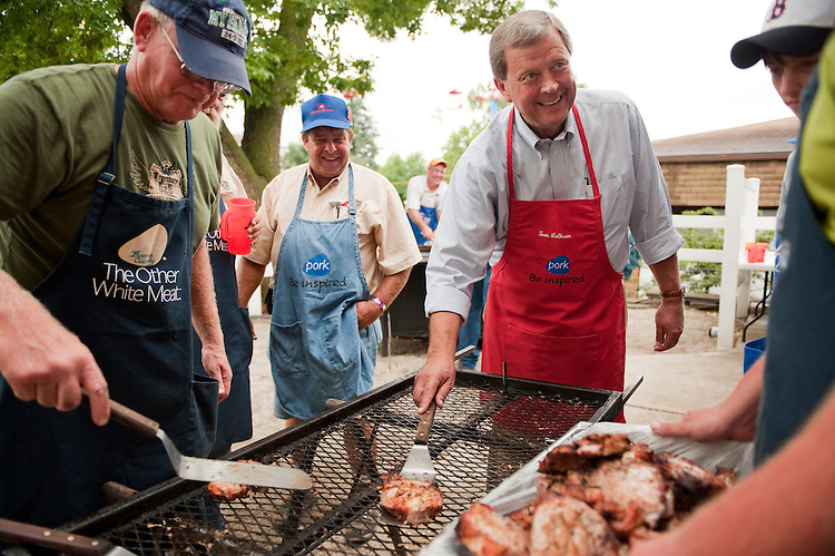 UNITED STATES - AUGUST 16:  Rep. Tom Latham, R-Iowa, right, helps gather pork chops at the Iowa Pork Producers Association pavilion at the Iowa State Fair in Des Moines, Iowa.  (Photo By Tom Williams/Roll Call)
