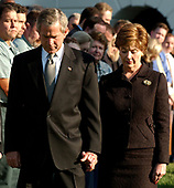 U.S. President George W. Bush and First Lady Laura Bush, bow their heads in prayer to mark the exact moment of the first terrorist attack on the World Trade Center at 8:46 AM two years ago at the White House in Washington, DC on September 11, 2003.<br /> Credit: Ron Sachs / CNP