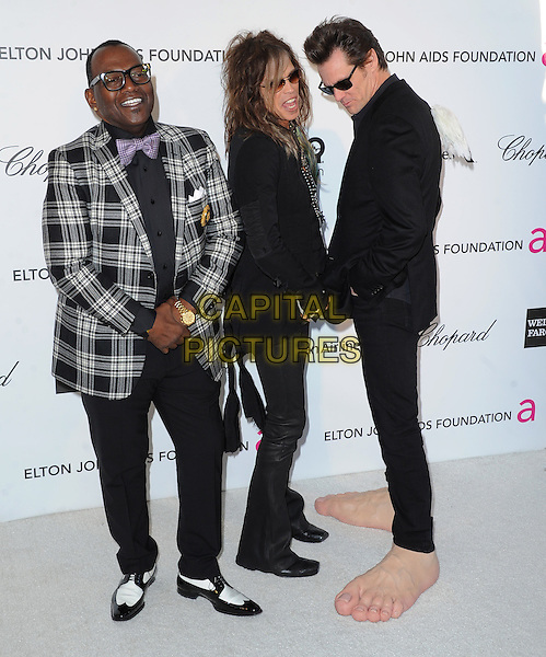Randy Jackson, Steven Tyler (of Aerosmith) & Jim Carrey.The 21st Annual Elton John AIDS Foundation Academy Awards Viewing Party held at The City of West Hollywood Park in West Hollywood, California, USA..February 24th, 2013.oscars full length grey gray check suit jacket leather trousers scarf necklace sunglasses shades funny giant large side oversized feet make-up prosthetics .CAP/DVS.©DVS/Capital Pictures.