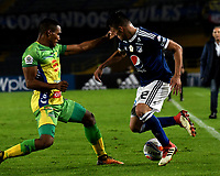 BOGOTA - COLOMBIA, 28–04-2018: Cristian Huerfano (Der.) jugador de Millonarios disputa el balón con Eddie Segura (Izq.) jugador de Atlético Huila, durante partido de la fecha 18 entre Millonarios y por la Liga Aguila I 2018, jugado en el estadio Nemesio Camacho El Campin de la ciudad de Bogota. / Cristian Huerfano (R) player of Millonarios vies for the ball with Eddie Segura (L) player of Atlético Huila, during a match of the 18th date between Millonarios and Atlético Huila, for the Liga Aguila I 2018 played at the Nemesio Camacho El Campin Stadium in Bogota city, Photo: VizzorImage / Luis Ramírez / Staff.