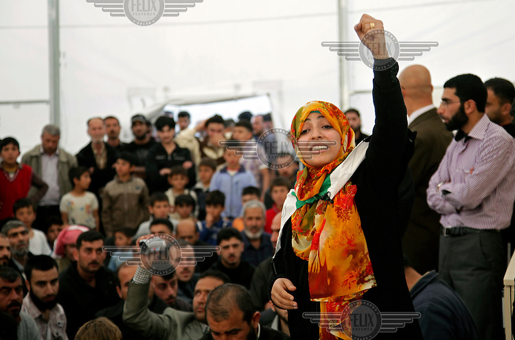 Yemeni activist Tawakul Karman, one of the Nobel Peace Prize winners of 2011, addresses a crowd of Syrian refugees at a camp.