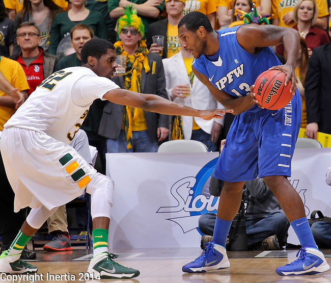 SIOUX FALLS, SD - MARCH 11:  Trayvonn Wright #32 of North Dakota State reaches on Luis Jacobo #13 of IPFW during their 2014 Summit League Men's Basketball championship game Tuesday evening at the Sioux Falls Arena.  (Photo by Dick Carlson/Inertia)