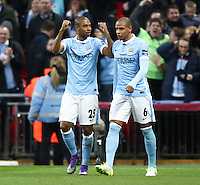 Fernandinho of Manchester City (left) celebrates scoring the opening goal against Liverpool during the Capital One Cup match between Liverpool and Manchester City at Wembley Stadium, London, England on 28 February 2016. Photo by David Horn / PRiME Media Images.