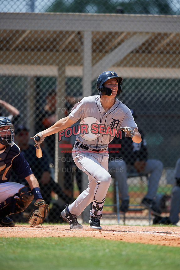 GCL Tigers West center fielder Parker Meadows (14) hits a single in front of catcher David Noworyta (39) during a game against the GCL Tigers East on August 8, 2018 at Tigertown in Lakeland, Florida.  GCL Tigers East defeated GCL Tigers West 3-1.  (Mike Janes/Four Seam Images)