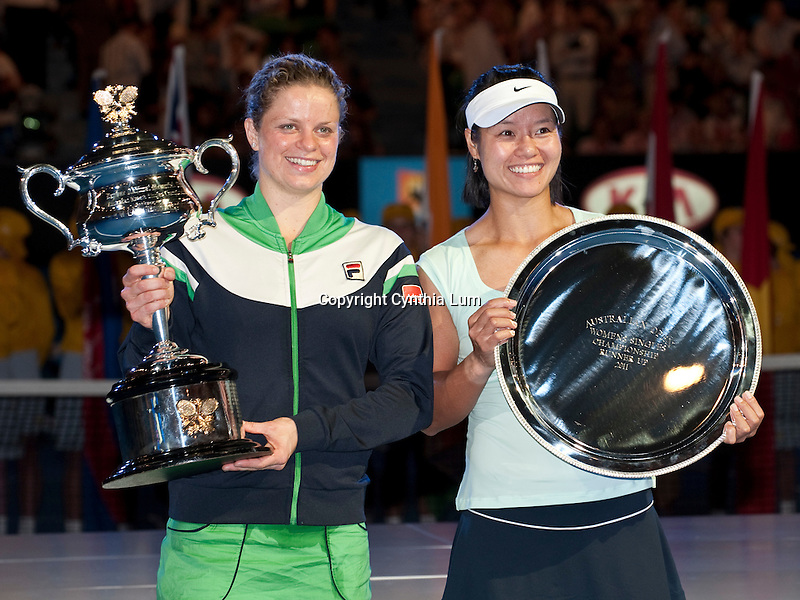 January 29, 2011.Kim Clijsters of Belgium, and Na Li of China pose with trophies after Clijsters defeated Li in the final at the Australian Open,Rod Laver Stadium, Melbourne Park, Melbourne, Australia.