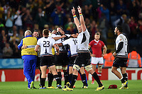 Romania players celebrate at the final whistle. Rugby World Cup Pool D match between Canada and Romania on October 6, 2015 at Leicester City Stadium in Leicester, England. Photo by: Patrick Khachfe / Onside Images
