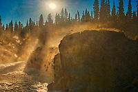 SUn streaking through the morning mist on the Grass River at Pisew Falls<br />