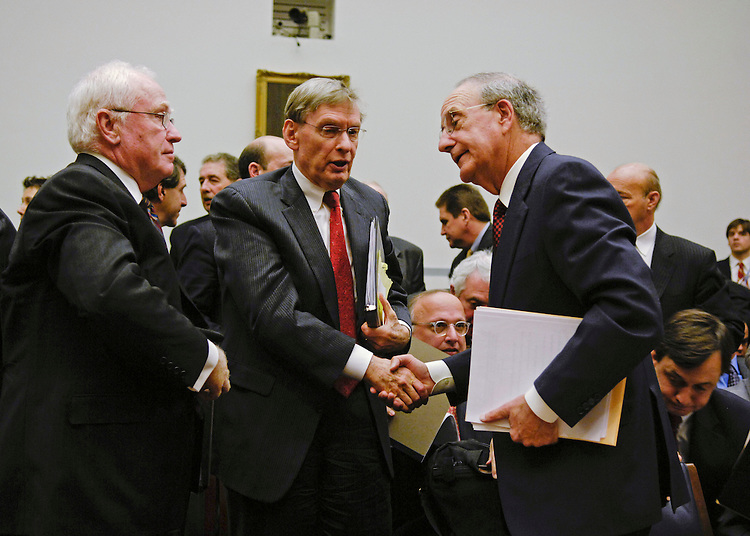 WASHINGTON, DC - Jan. 15, 2008: Major League Baseball President Bob DuPuy,, Major League Baseball Commissioner Bud Selig, and former Sen. George Mitchell, who released a scathing report last month on Major League Baseball's abuse of steroids, human growth hormone and other performance-enhancing substances, during a break after Mitchell testified during the House Oversight and Government Reform Committee hearing on Mitchell's report. Under pressure from lawmakers, Major League Baseball officials on Tuesday agreed to make more changes to the sportÕs antidrug policies before 2008 spring training begins. House Oversight and Government Reform Committee leaders said they were encouraged by the commitment. It came after a plea from former Sen. George Mitchell Ñ the investigator who revealed the breadth and depth of baseballÕs drug problems Ñ for Congress to Òencourage and allowÓ the league to clean up its own act. (Congressional Quarterly Photo by Scott J. Ferrell)