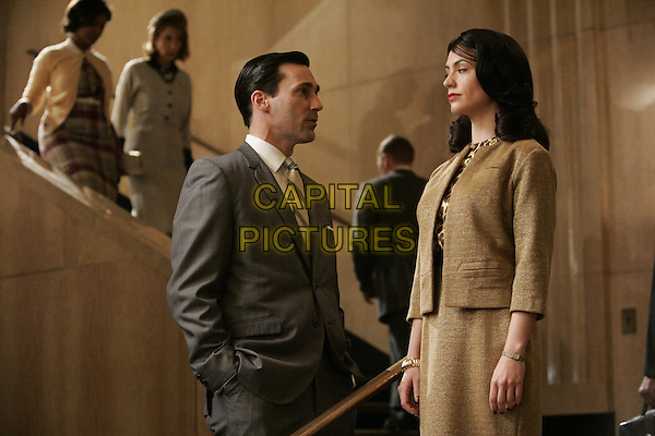 JON HAMM &amp; MAGGIE SIFF<br /> in Mad Men (Season 1)<br /> *Filmstill - Editorial Use Only*<br /> CAP/FB<br /> Image supplied by Capital Pictures