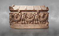 "Picture of Roman relief sculpted Sarcophagus of Garlands, 2nd century AD, Perge. This type of sarcophagus is described as a ""Pamphylia Type Sarcophagus"". It is known that these sarcophagi garlanded tombs originated in Perge and manufactured in the sculptural workshops of Perge. Antalya Archaeology Museum, Turkey."