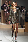 Model walks runway in a gold chain sequin GABRIELE dress with gathered shoulder detail and skater style skirt, from the Greta Constantine Spring Summer 2018 collection by Kirk Pickersgill and Stephen Wong on September 6, 2017; at Pier 59 Studios during New York Fashion Week.