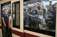 Rome, Italy, June 21, 2017. Gente nella metropolitana. People in the subway.<br /> Ad un anno dalla elezione a sindaco di Roma di Virginia Raggi, la condizione di degrado non accenna a migliorare.<br /> One year after the election as mayor of the candidate of M5S party, Rome is worsening day by day.