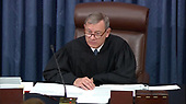 In this image from United States Senate television, Chief Justice of the United States John G. Roberts, Jr. adjourns the US Senate until 1:00pm EST on Wednesday, January 29 after White House Counsel Pat Cipollone completed his final argument during the impeachment trial of US President Donald J. Trump in the US Senate in the US Capitol in Washington, DC on Tuesday, January 28, 2020.<br /> Mandatory Credit: US Senate Television via CNP