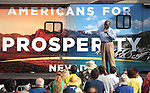 Herman Cain addresses a crowd of GOP supporters at an Americans for Prosperity rally in Reno, Nev., on Monday, July 23, 2012..Photo by Cathleen Allison