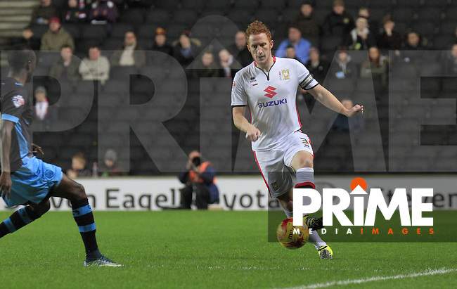 Dean Lewington of MK Dons looks to play the ball down the wing during the Sky Bet Championship match between MK Dons and Sheff Wednesday at stadium:mk, Milton Keynes, England on 15 December 2015. Photo by Liam Smith.