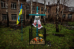 Pisky, Nr Avdiivka, eastern Ukraine, Nov. 2017.<br /> <br /> A religious shrine in the devastated village of Pisky. <br /> <br /> The village is on the front-line and under frequent attack by sniper, rocket and artillery fire from pro-Russian separatists.<br /> <br /> Despite the extensive destruction to the surrounding buildings the memorial has remained undamaged.