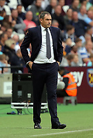 Swansea manager Paul Clement stands on the touch line during the Premier League match between West Ham United v Swansea City at the London Stadium, London, England, UK. Saturday 30 September 2017