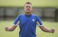 THE POSTMAN DELIVERED. Ian Poulter (Team Europe) stirs the gallery on the 18th during Sunday's Singles, at the Ryder Cup, Le Golf National, Île-de-France, France. 30/09/2018.<br /> Picture David Lloyd / Golffile.ie<br /> <br /> All photo usage must carry mandatory copyright credit (© Golffile | David Lloyd)