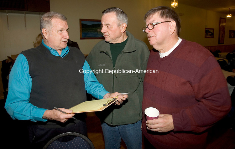 WATERBURY CT. 01 December 2014-120114SV06-From left, Joe Savoy of Waterbury, retired police, Phil Franco of Middlebury, retired police, and Ed Caisse of Woodbury, retired fire, enjoy a Waterbury Police &amp; Firefighters Retiree Association Christmas Party held at the Ancient Order of Hibernians Club in Waterbury Monday.<br /> Steven Valenti Republican-American