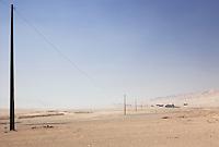 Telegraph poles stretching into the Atacama desert from the La Silla Paranal Observatory, Atacama desert, Chile