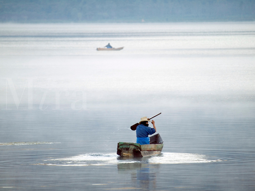 Guatemala, Santiago Atitlan,  Fishermen at work on Lake Atitlan, which is a lake surrounded by three volcanoes in the highlands.
