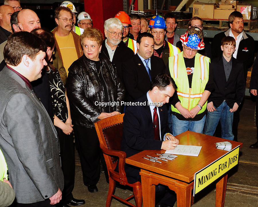Gov. Scott Walker signs the mining bill, which eases restrictions on receiving a permit from the Wisconsin DNR to mine land just south of Lake Superior in Wisconsin.