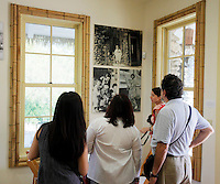 Relatives of the Jingu family and event attendees look at photo prints hanging on the wall during the grand re-opening of the Jingu House, Saturday, Oct. 22, 2011, at the Japanese Tea Garden in San Antonio, Texas, USA. (Darren Abate/pressphotointl.com)
